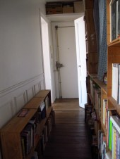 Goodbye to the hallway full of French wine crate book shelves