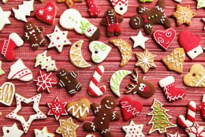 48771931 - christmas cookies on a red wooden table