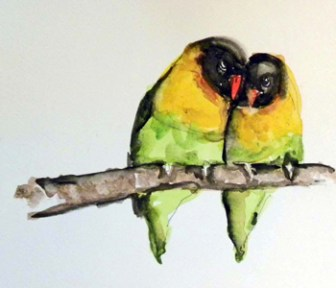 Black, yellow and green love birds sitting on a perch.