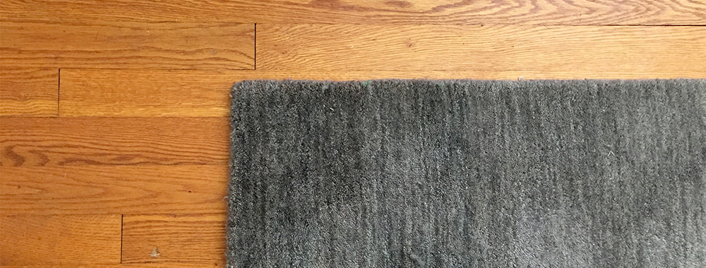 Revealing the gorgeous hardwood under my (hated) Wall-to-Wall Carpet