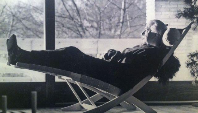 Hans Wegner relaxing in his chair