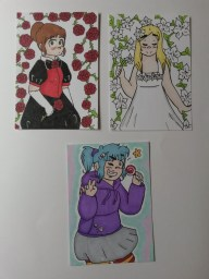 I hand draw and colour art cards to hand out to the interesting people I meet. The cards have my character designs on one side and my contact details on the other. These art cards are from June 2016 and feature my own original characters.