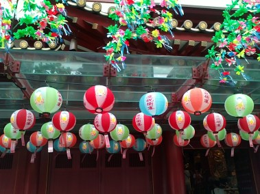 a closer look at Buddha Tooth Relic's bright lanterns