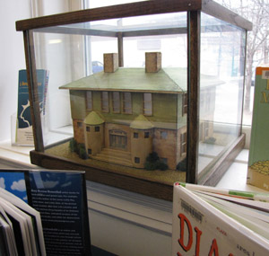 A tiny version of the Westport Library sits in a library window.