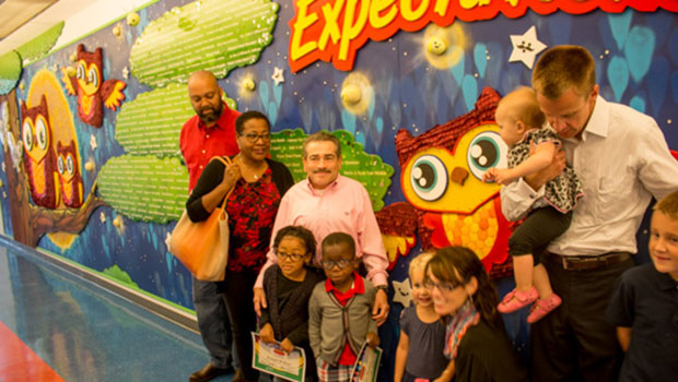 Jim LaManno (pink shirt) met the children and their families of the first Terri LaManno Scholarships yesterday.