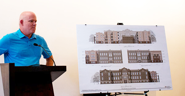 Developer Del Hedgepath explained his plans for the Norman School at a neighborhood meeting last night.