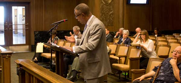 Attorney Mark Bryant told the City Plan Commission Highwoods Properties, owner of the Plaza, opposes the Midtown/Plaza area plan. The commission gave unanimous approval to the draft plan and sent it on to the city council for consideration.