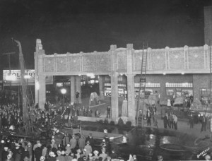 This photo shows a crowd gathered as a fire burns at the Firestone Building. Date unknown.
