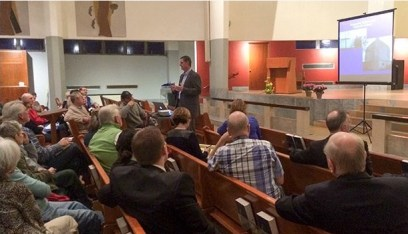 File photo. Hundreds of people have turned out for meetings about a Catholic student housing project like this one in 2015.