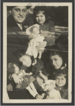 Unknown maker, American. Double Exposure: Girls with dolls and father, ca. 1945. Gelatin silver print, 3 3⁄4 x 2 1⁄2 inches. Gift of Peter J. Cohen, 2015.9.111.