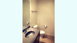 Nice bathroom with large vanity in a campus apartment