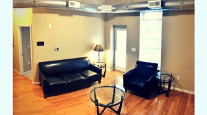 Furnished living room in an updated campus apartment