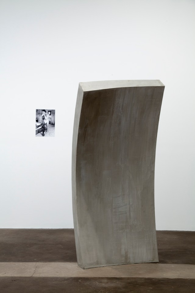 Untitled, 2010. Laser print, concrete, plywood, wood, screws, steel handrail. 16 x 11 ¼ inches and 78 x 41 x 27 inches.