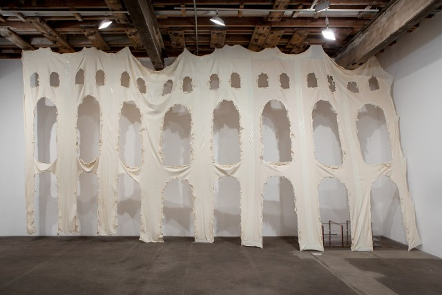 No title, 2014. Aqueduct: latex, cotton; Vitrine: latex, acrylic, leather, stainless steel, lamp, iPad, video, vegetable oil, bubble solution, poly bags. 172 x 330 x 60 inches.