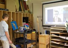 Studio art student skyping with Jane Ryder (IA)