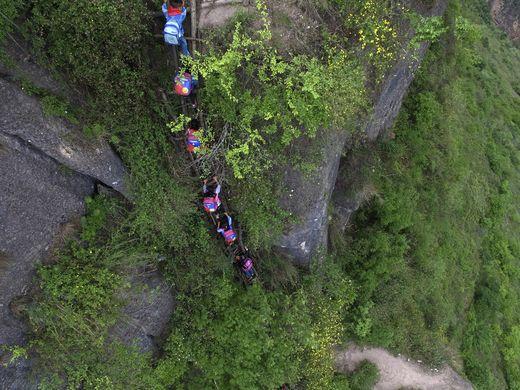 635999473892080701-AP-China-Village-Ladder.2