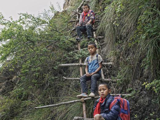 635999476175184606-AP-China-Village-Ladder.3