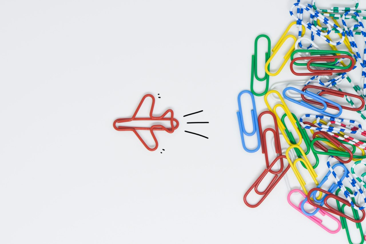 Red paperclip turned into an airplane