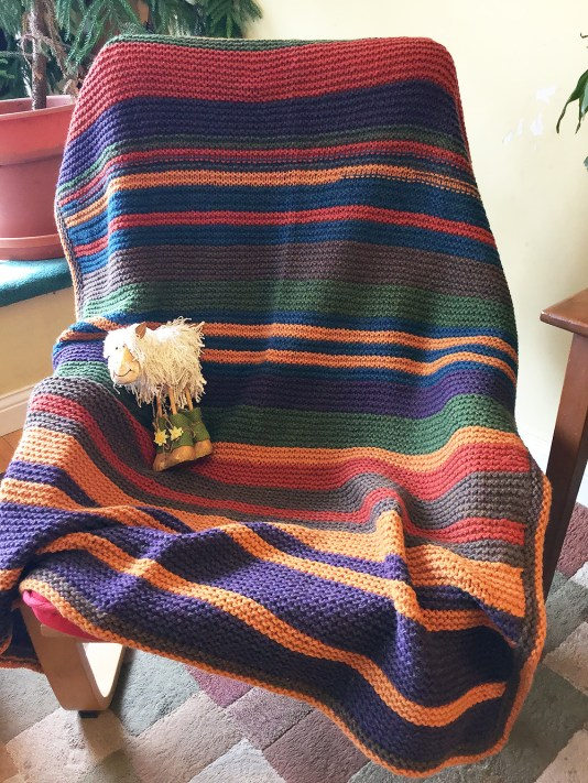Customer knit blanket from The Cat and Crow house-brand (made) yarn.