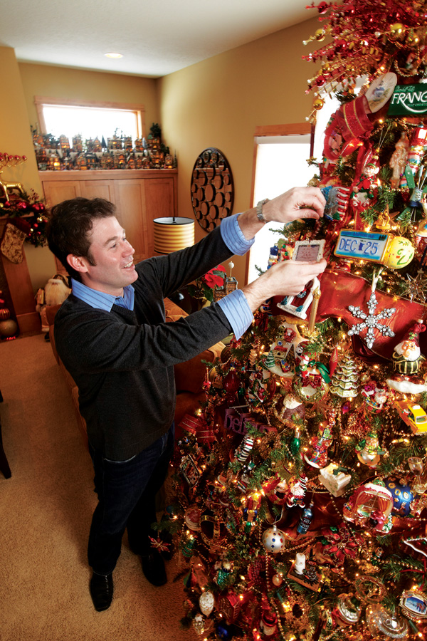 Ryan Smith adds finishing touch to Christmas tree