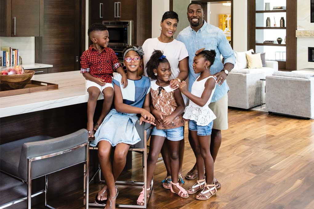 A portrait of Greg Jennings' family in their home.