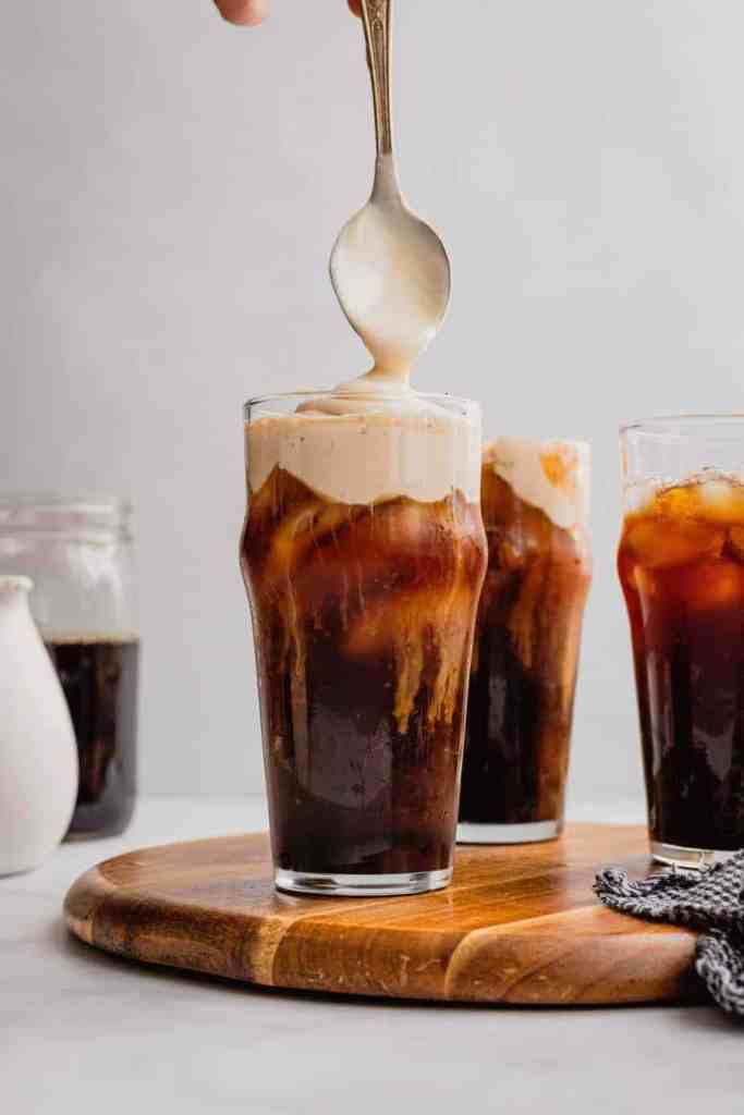An iced cold brew coffee gets topped with homemade Irish cream cold foam.