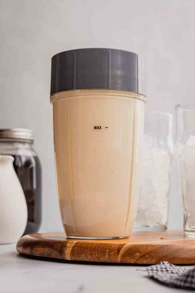 A blender filled with homemade sweet cream cold foam.