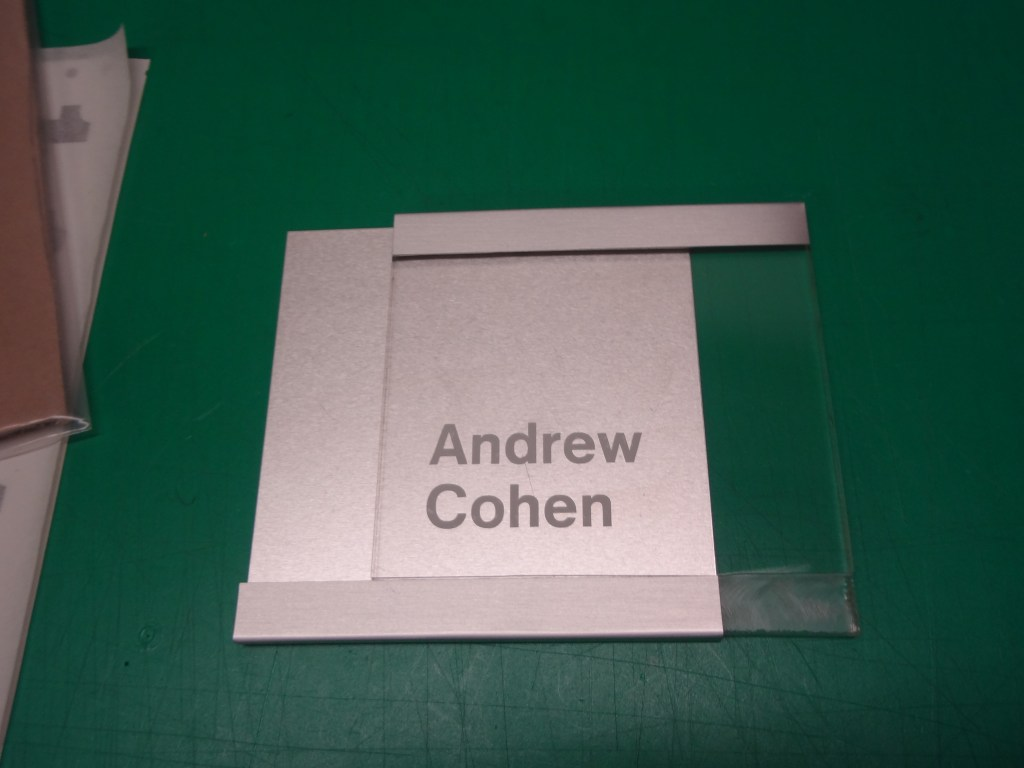 Clear acrylic with brushed aluminium sign Image