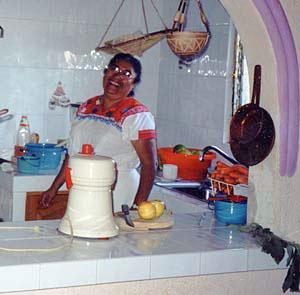 Doña Irene Sotelo in kitchen