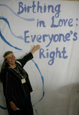 """Jan Tritten shows off the conference theme, """"Birthing in Love: Everyone's Right"""""""