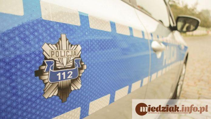 Miedziak Policja bok radiowozu 112