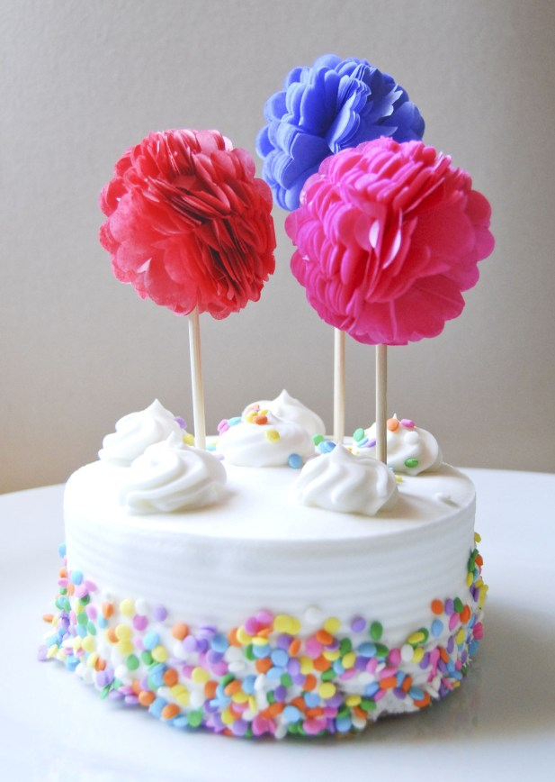 Tutorial: http://www.cutoutandkeep.net/projects/tissue-paper-cupcake-pom-poms-2