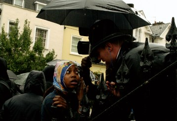 Street Party, Rain, Dancing, police, police officer, policeman, London Metropolitan Police Force