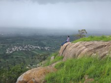 Lone man at the top of the hill