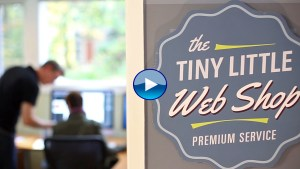 Tiny Little Web Shop logo, people working in the background