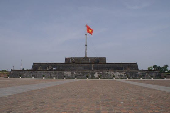 Citadel's exterior with huge Viet Nam flag and pole