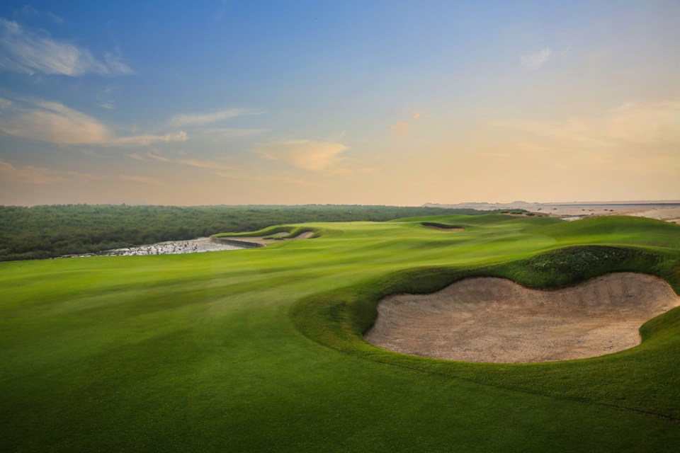 Manicured fairways and greens alongside an abundance of natural wildlife, 12 km of waterfront and a tidal system that alters the dynamics of Al Zorah on an hourly basis. Photo by Troon Golf