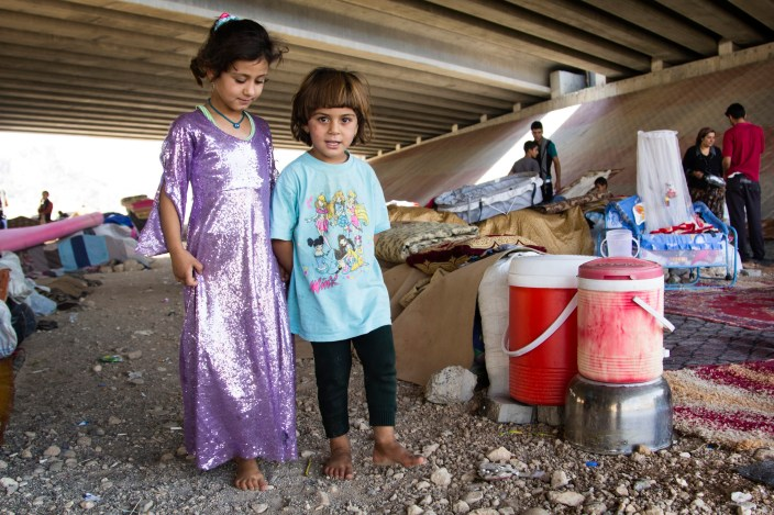DUHOK, IRAQ: Yezidi families who fled the advance of Islamic State forces in Sinjar shelter under a bridge in the Kurdish city of Duhok. On June 5, 2014, the Islamic State of Iraq or ISIS and aligned forces began a major offensive in northern Iraq and the Iraqi Government. This conflict led many Iraqis to flee their homes in search of Safety. Caritas Iraq and CRS have been supporting these internally displaced civilians. © Hawre Khalid / Metrography for Catholic Relief Services