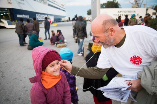Caritas Athens, a partner of CRS, runs a soup kitchen and also provides clothes, vouchers for shelter and information for passing refugees and economic migrants. Part of their outreach is to be present at the port to inform arriving refugees before they are taken by smugglers and exploited. The little girl pictured arrived that morning to Athens. This year, thousands have fled countries in northern Africa and the Middle East seeking asylum in different parts of Europe. Catholic Relief Services (CRS) and Caritas are scaling up their humanitarian relief efforts to address these growing needs in Serbia, Macedonia and Greece. This is part of the Balkan Refugees - Migrants Response project.