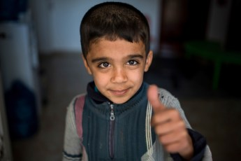 "MAFRAQ-JORDAN Zakria (8), from Syria, waiting in the ""Child Friendly Space"" in the Protection Center where some ICMC staff play with the children."
