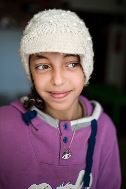 """MAFRAQ-JORDAN Malak (10), from Syria, waiting in the """"Child Friendly Space"""" in the Protection Center where some ICMC staff play with the children."""
