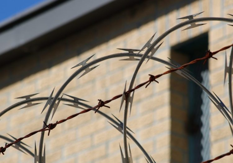 black-metal-wire-fence-near-brown-concrete-building-3993513