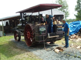 Old Case Steam Tractor hooked up to a sawmill