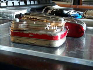 Keys bolted to an Altoids tin as a keychain