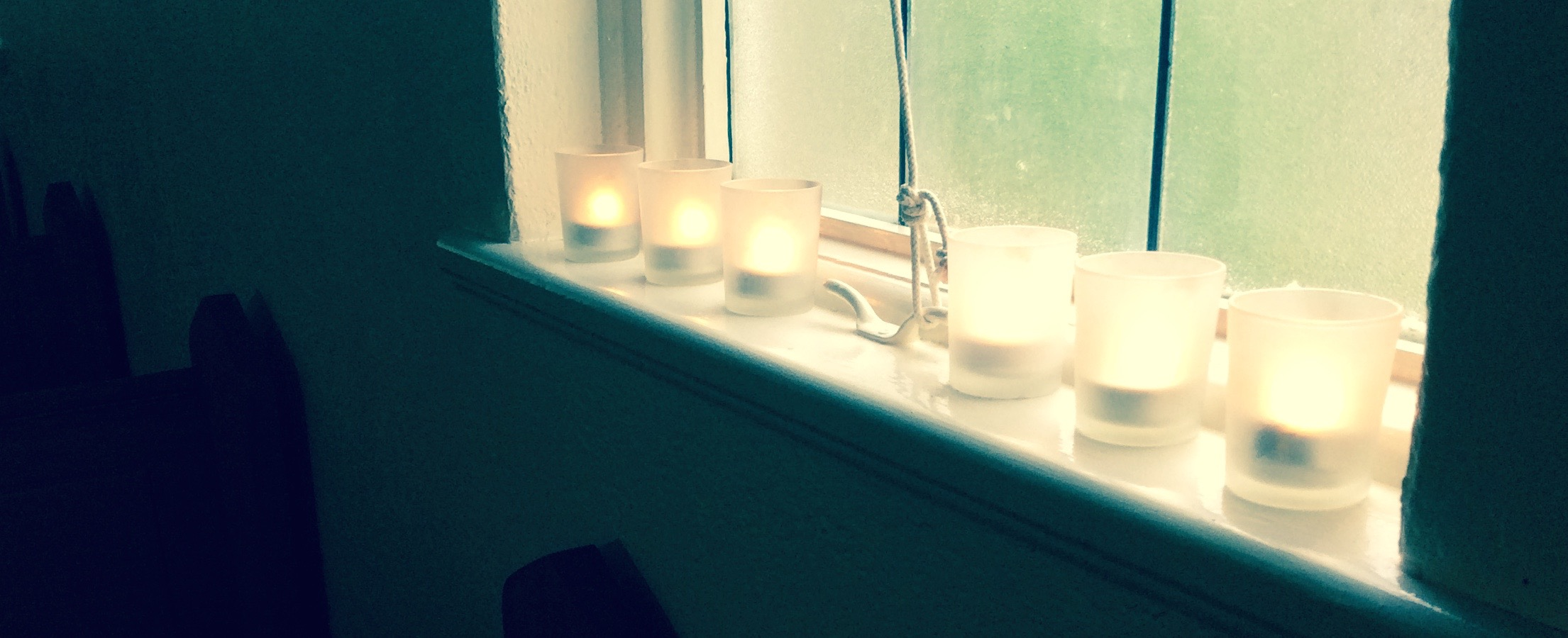Image of Candles near a window for a Blue Christmas
