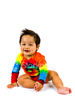 ist2_4448466-cute-baby-boy-in-rainbow-outfit-sitting