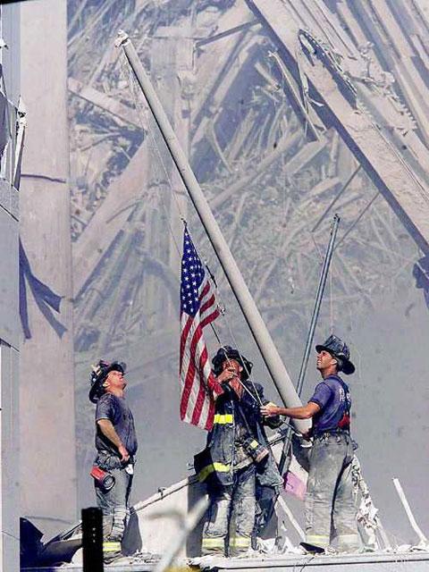 firemen-raising-flag