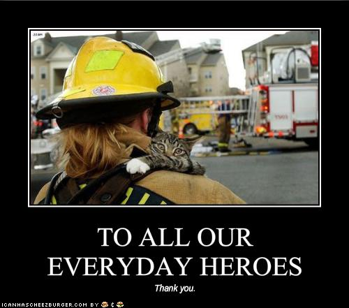 funny-pictures-cat-says-thank-you-to-his-fireman-rescuer