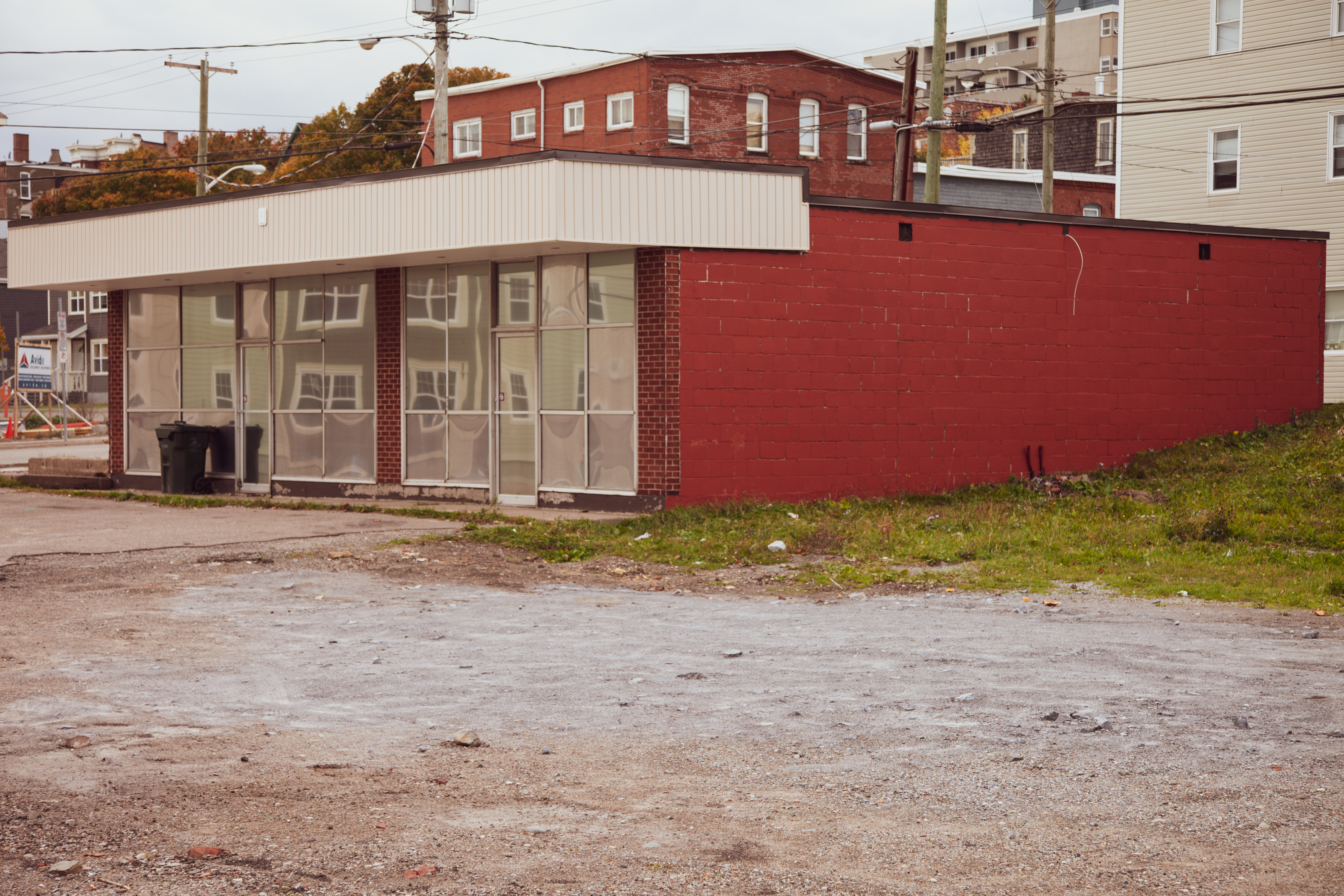 A photograph depicting Empty Storefront Near Wenworth Street Full