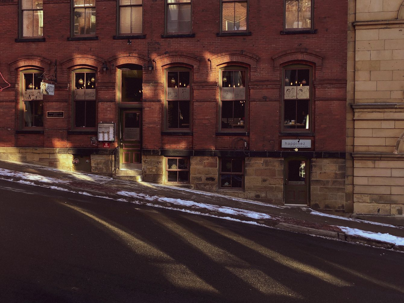 Click thumbnail to see details about photo - Shadows and Highlights on Britts Pub Photograph